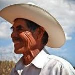 smiling man in cowboy hat